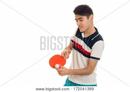 portrait of cheerful sportsman practicing a ping-pong and concentrated on a game isolated on white