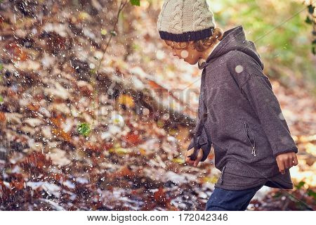 Child playing an autumnal day in Majorca