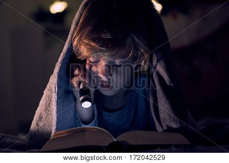 Reading a book in the room of your house
