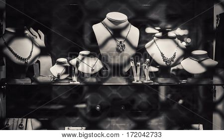 Closeup view on window of a shop for selling jewelry and other treasures.