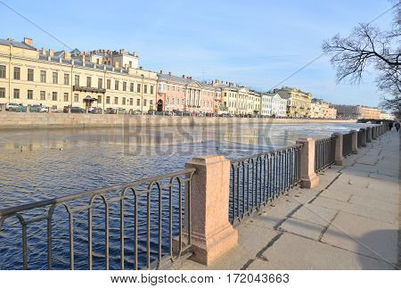 Embankment of Fontanka River. Flow of the Neva delta in St. Petersburg at sunny spring day.