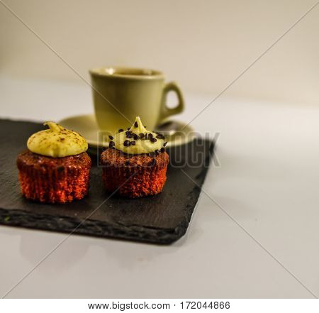 side view on two sweet cupcakesstrawberry and creamy chocolate background delicious aroma of black coffee sweet dessert
