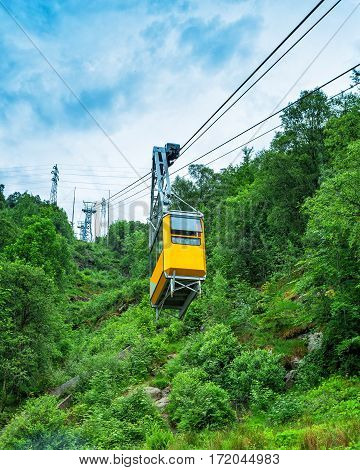 Cableway lift gondola cabins on summer mountains background beautiful scenery