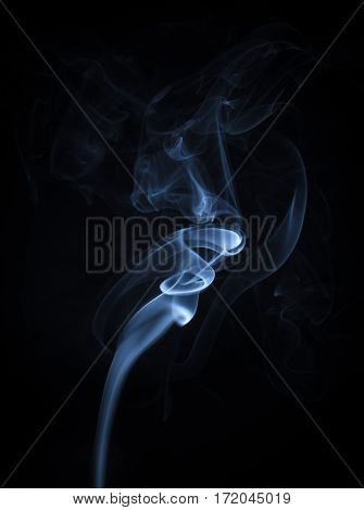 Abstract Blue Smoke Flowing Vertical on Black Background