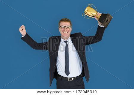 Business Man Holding Trophy Happy
