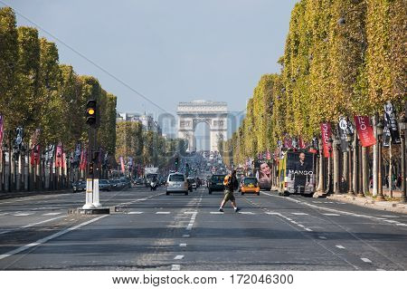 PARIS FRANCE - OCTOBER 11 2015: The Avenue des Champs-Elysees is a boulevard in Paris running between the Place de la Concorde and the Place Charles de Gaulle where the Arc de Triomphe is located