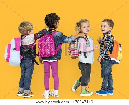 Little Children Carrying Backpack School