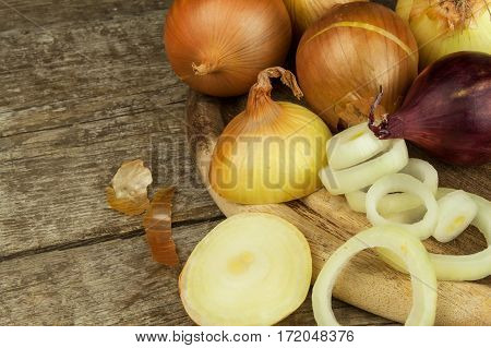 Fresh Onion On An Old Wooden Table. Food Preparation. Slicing Onions.