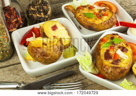 Stuffed Baked Potatoes On A Wooden Table. Healthy Food. Homework Dinner.