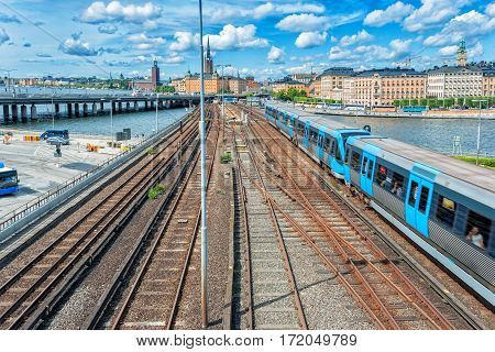 Railway tracks and trains in main train station in Stockholm, Sweden in sunset