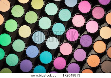 Colorful makeup powder texture as background. Makeup eyeshadow palette