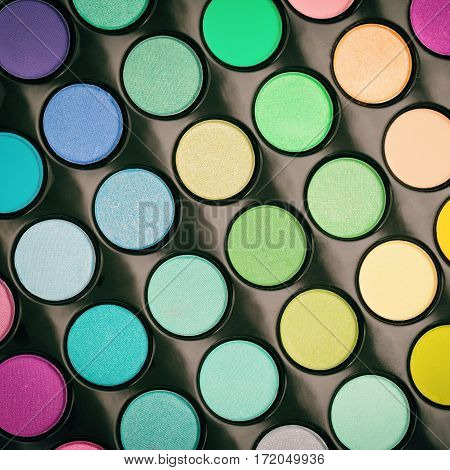 Makeup palette background. Eyeshadow palette. View from above