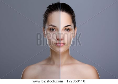 Comparison portrait of woman. Divided face of woman with perfect skin. One half of face without  retouch, before. Another half of face with retouch, after. Studio, head and shoulders, indoors. Gray background