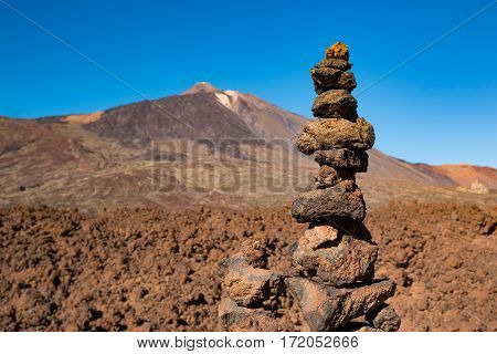 Stone pyramid and Teide National Park in Tenerife Canary Islands Spain