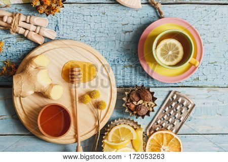 Cups With Herb Tea And Pieces Of Lemon On The Wooden Background