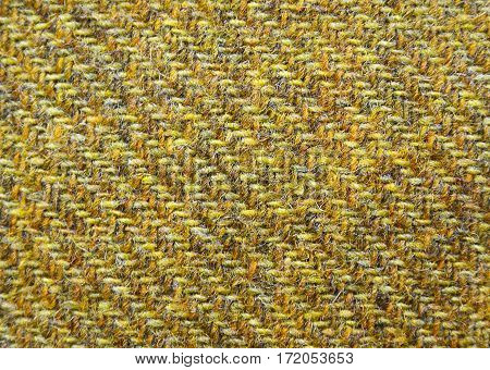 Yellow tweed as a background or texture.Wool pattern,rough fabric texture,textured melange upholstery fabric background.