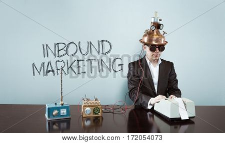 Inbound marketing text with vintage businessman and calculator at office
