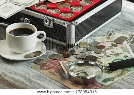 Collector's Coins And Banknotes, Magnifying Glass And Box For Coins