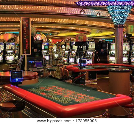 Cruise liner Voyager of the Seas - April 10, 2017: Poker gaming table in American gambling casino