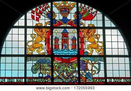 Copenhagen, Denmark - April 3, 2017: Stained-glass window with coat of arms in city hall of Copenhagen