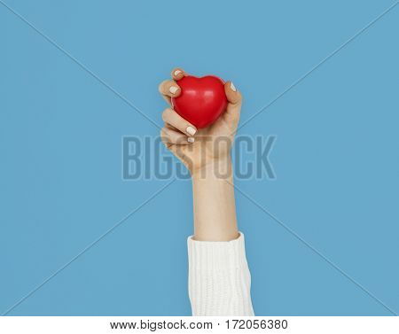 Hand holding red heart concept