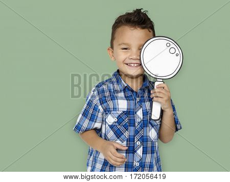 little boy holding magnifying glass for exploration