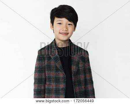 Asian boy is in a studio shoot.