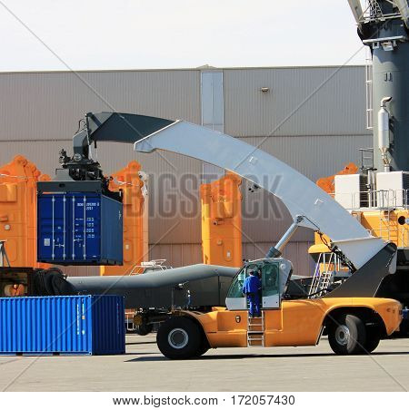 Rostock, Germany - April 20, 2017: Container loader reach stacker in the test area of Liebherr crane building factory Rostock, Germany.