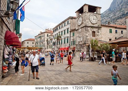 Kotor, Montenegro - August, 2016: St. Luke's Church on St. Luke's square with tourists walkingin Kotor old town.