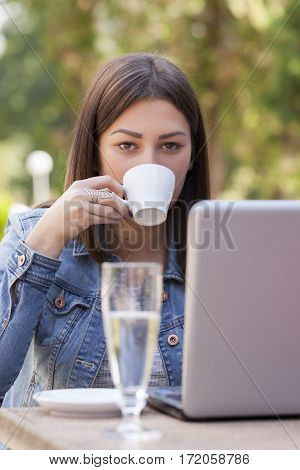 Young business woman on coffee break Selective focus and small depth of field