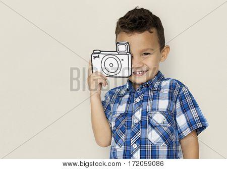 Little boy holding papercraft camera for aspiration