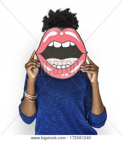 African Woman holding Peper Mouth Over her Face