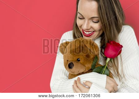 Young Lady Hugging Teddy Rose Smiling