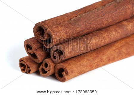 a stack of cinnamon sticks isolated on white background.