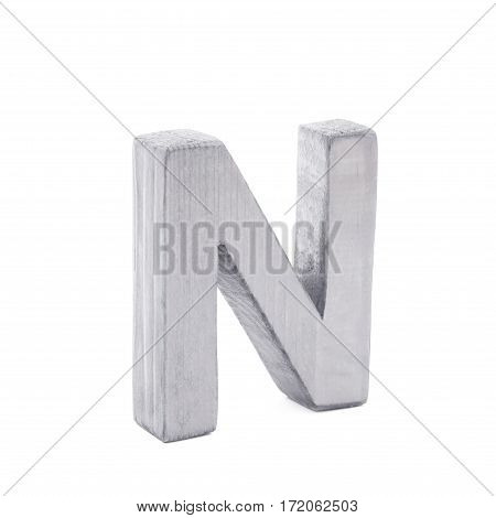 Single sawn wooden letter N symbol coated with paint isolated over the white background