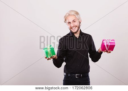 Man Holding Two Gift Boxes In Hands