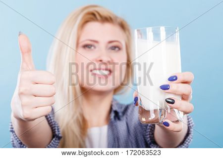 Woman Holding Glass Of Milk Showing Thumb Up
