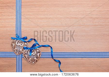 Valentine's Day card. Two hearts on a wooden background