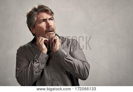 Afraid surprised mature caucasian man face expressions.