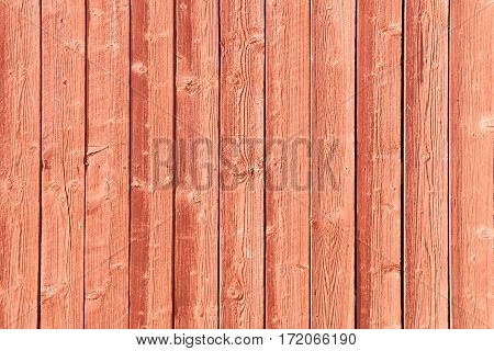 Traditional red wall made of verical planks