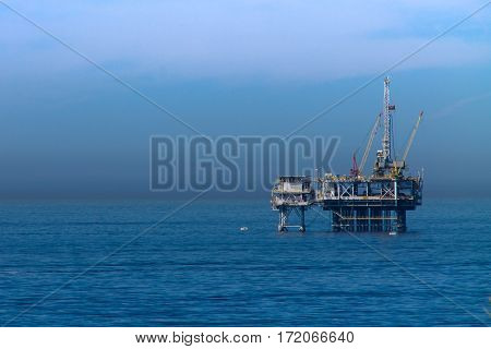 Off shore oil rig in the blue ocean