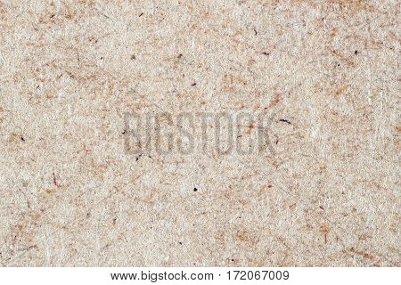 Paper texture cardboard background close-up. Grunge old paper surface texture. Environmental or Kraft paper is characterized by high wear resistance and toughness,