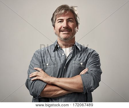 Smiling handsome man portrait over gray wall background