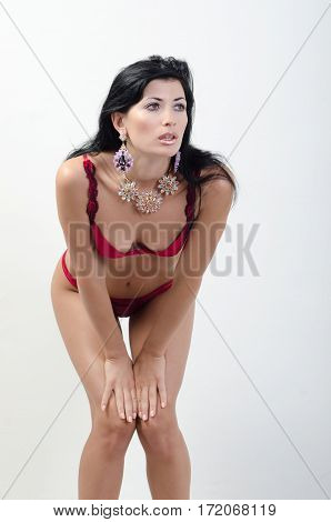 a girl in red билье looks in distance