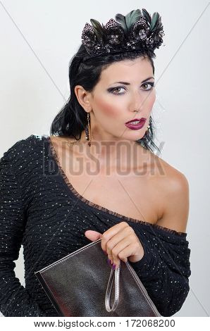 Girl in a black dress and with a bag