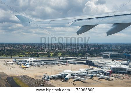 Sydney, Australia - Oct 29, 2016: Moments after plane takes off from airport. Below is Sydney Kingsford-Smith International Airport.