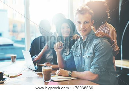 Young Entrepreneurs In Cafe Or Office