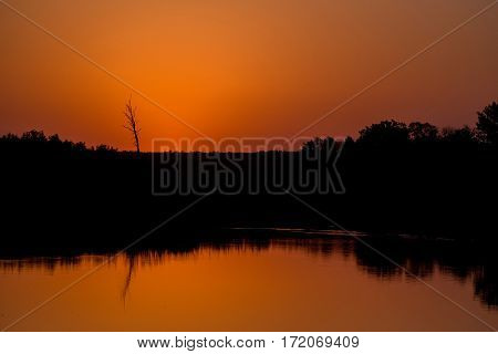 Sunset summer landscape with steppe and river in Russia