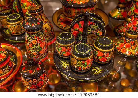 Collection of russian traditional wooden utensil in Khokhloma painting style
