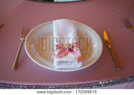 Table appointments in restaurant. Pink wedding preparation